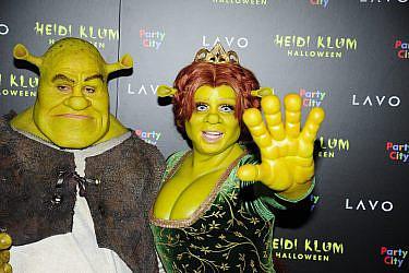 היידי קלום ובן הזוג טום קאוליץ מחופשים לשרק ופיונה במסיבתהאלווין | צילום: Paul Bruinooge/Gettyimages