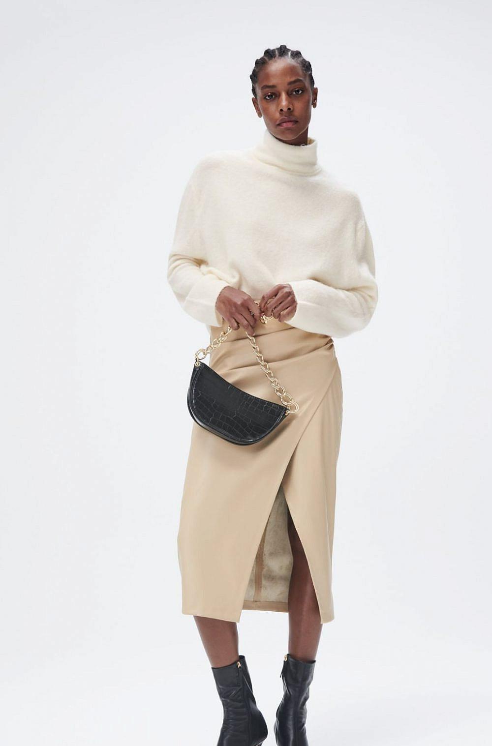 """זארה, חצאית דמוי עור עם קפלים 199 ש""""ח   צילום מסך מאתר זארה"""